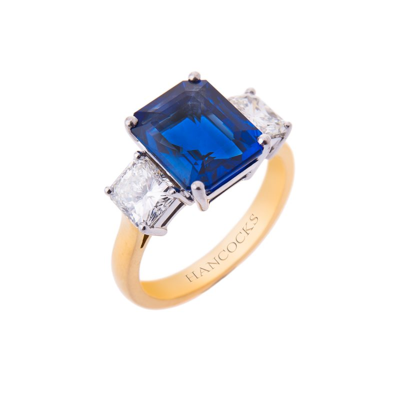 rectangular sapphire with emerald cut diamonds mounted in 18ct yellow gold claw setting
