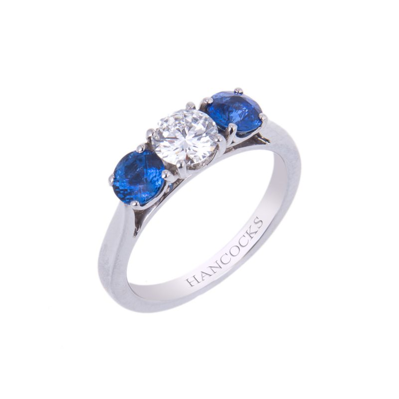 sapphire 3 stone ring with central brilliant cut diamond