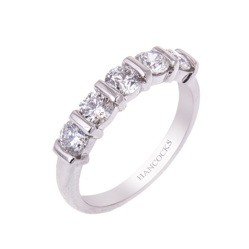platinum half eternity ring set with 5 brilliant cut diamonds in a bar setting