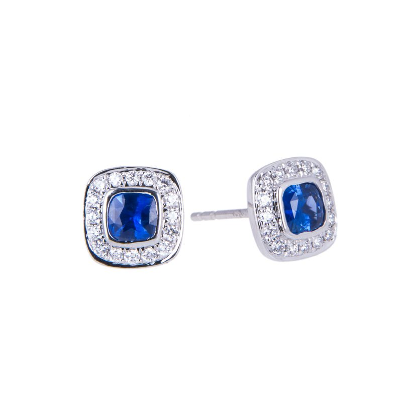 18ct white gold cushion cut sapphire and diamond earrings with a halo setting