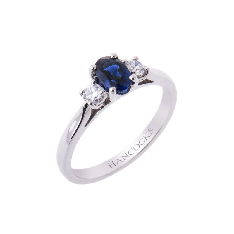claw set sapphire and diamond three stone ring