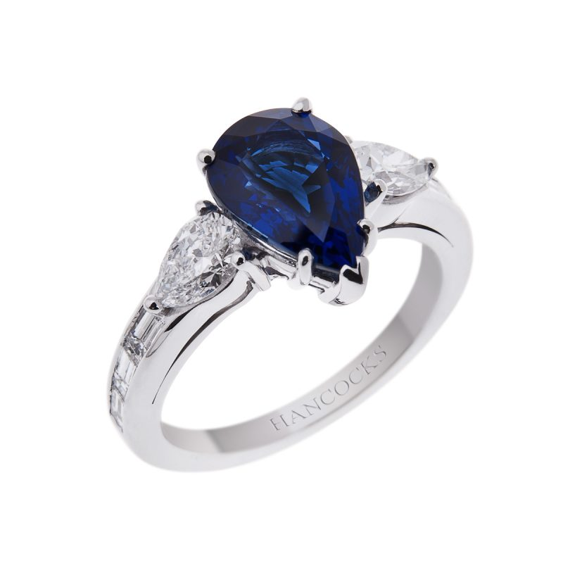 pear cut sapphire mounted with pear cut diamonds in a platinum setting