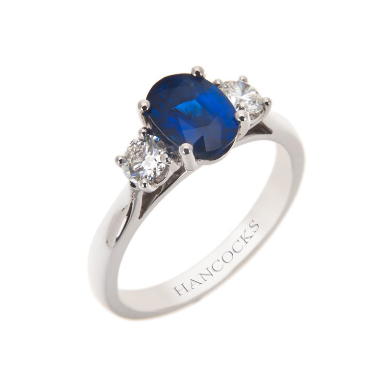 claw set oval sapphire and diamond 3 stone ring in platinum