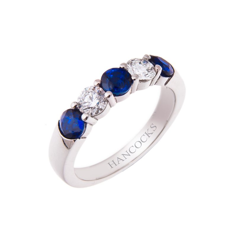 platinum sapphire and diamond five stone half eternity ring mounted in a claw setting