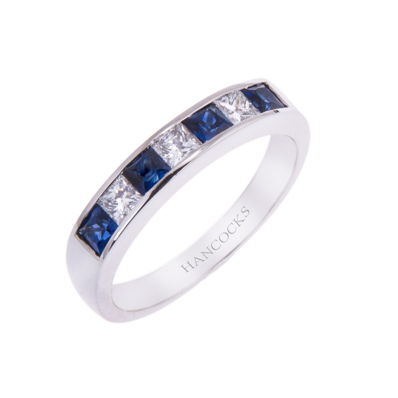 platinum channel set sapphire and diamond half eternity ring