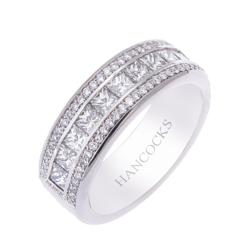 platinum wedding band with princess and brilliant cut diamonds