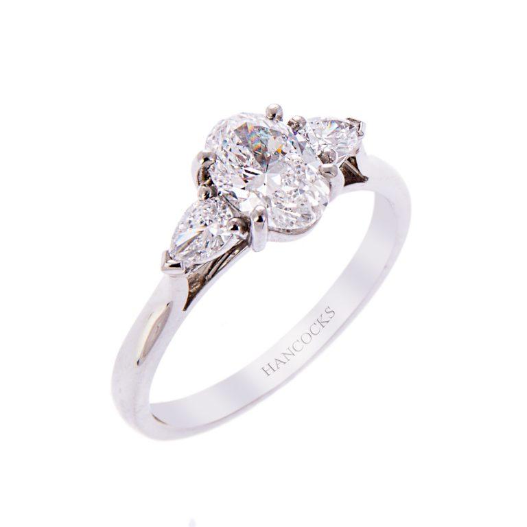 Platinum Oval Cut Diamond Three Stone Ring