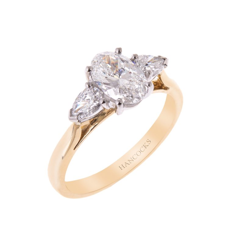 oval-and-pear-cut-diamond-3-stone-ring