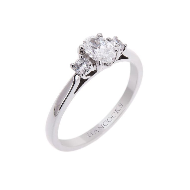 4H 10 oval diamond 3 stone ring
