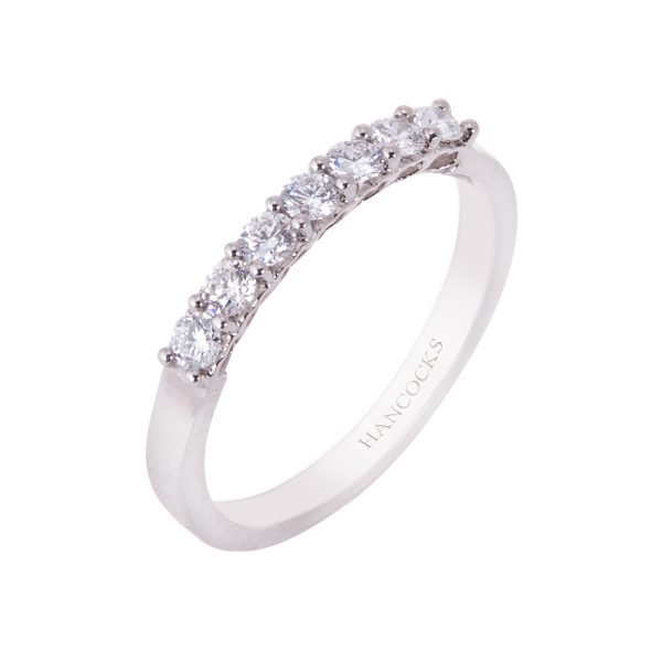 platinum claw set brilliant cut diamond half eternity ring