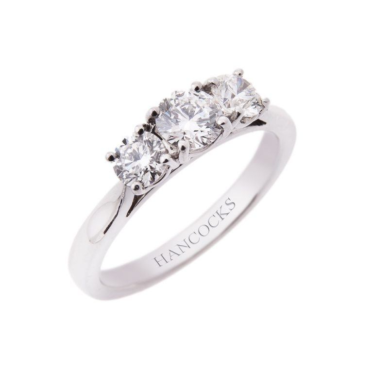 H 23 brilliant cut diamond 3 stone ring