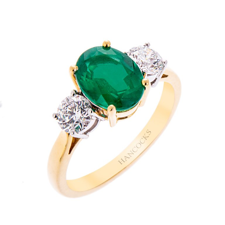 H140920 4918ct gold oval emerald and diamond ring