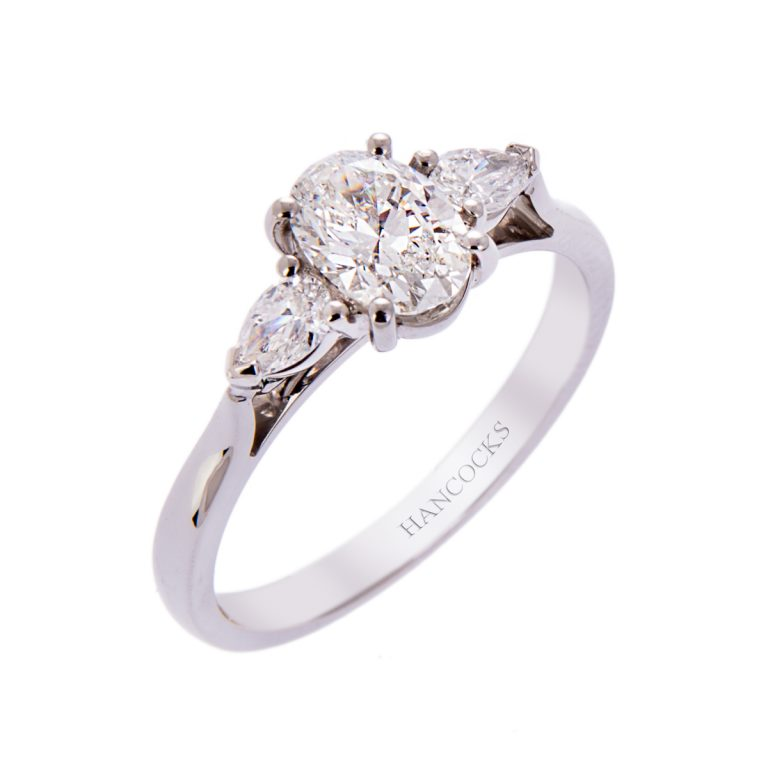 H140920 6 platinum 0.70ct oval cut diamond 3 stone ring with pears