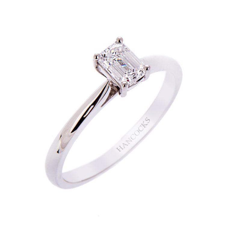 H140920 9 platinum emerald cut diamond single stone ring