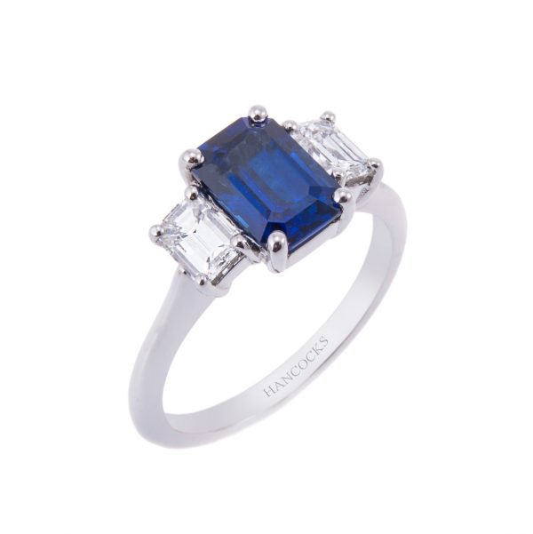sapphire and emerald cut diamond three stone ring in platinum