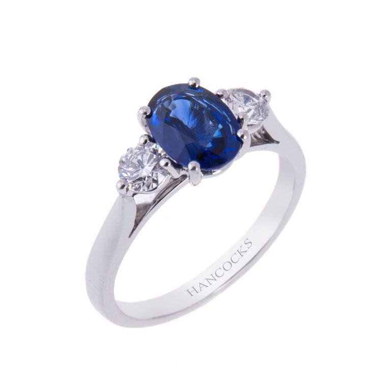 brilliant cut diamond and oval cut sapphire three stone ring in platinum HANCX 9