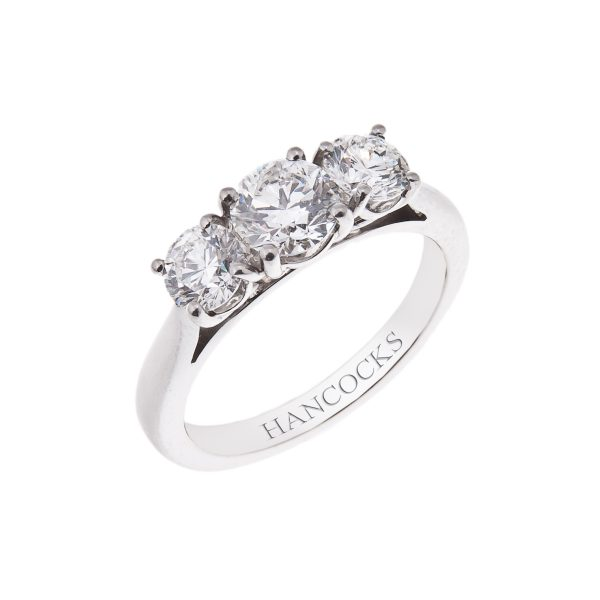 brilliant cut diamond 3 stone ring in a platinum claw setting