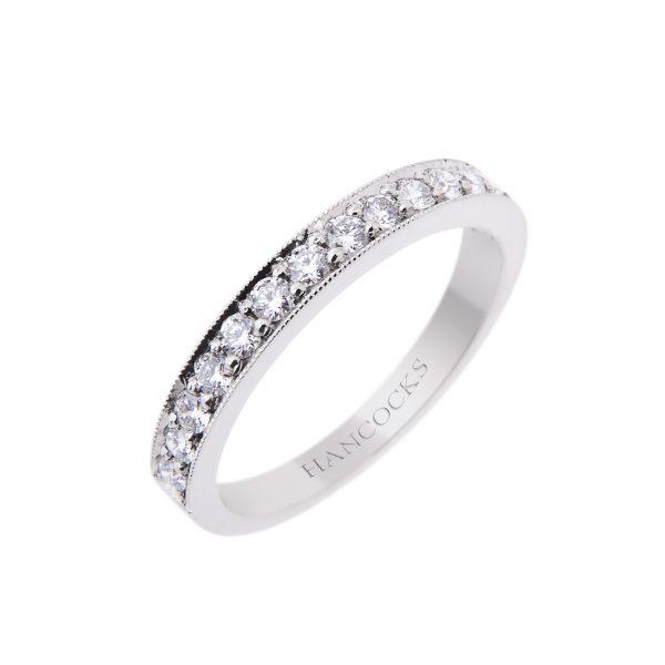 brilliant cut diamond half eternity ring with a platinum grain setting