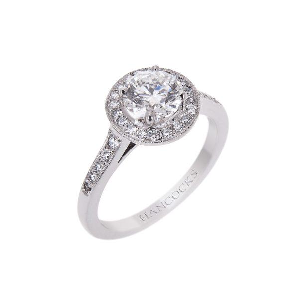 vintage style brilliant cut diamond halo set ring in platinum