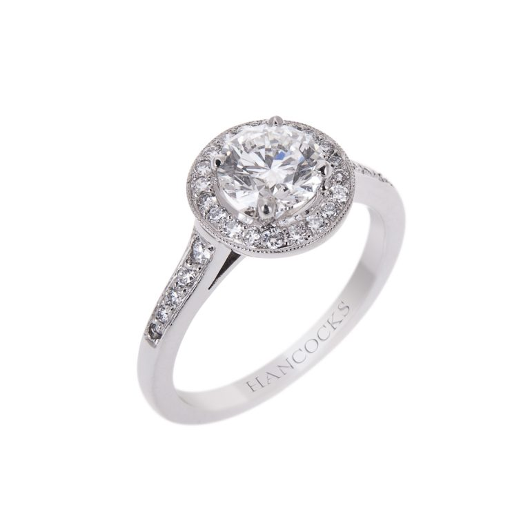 vintage style brilliant cut diamond halo set ring in platinum