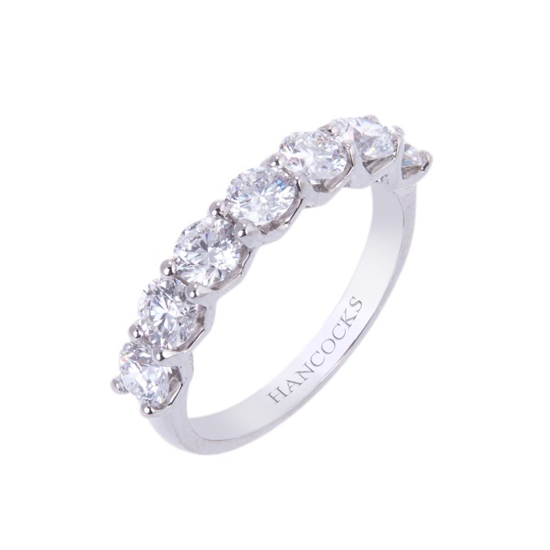platinum brilliant cut diamond half eternity set with 7 diamonds in a claw setting