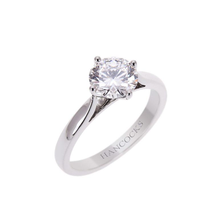 brilliant cut diamond single stone ring in a platinum compass setting