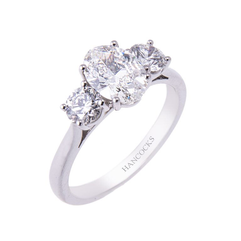 certificated oval cut diamond 3 stone ring in platinum HA 12