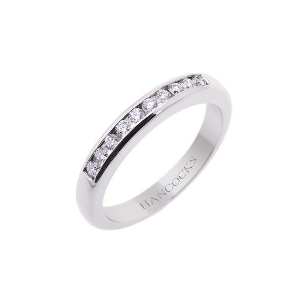 brilliant cut diamond set half eternity ring with a channel setting