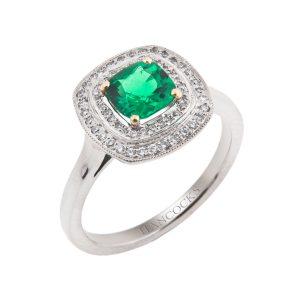 platinum cushion cut emerald with double brilliant cut diamond halo surround