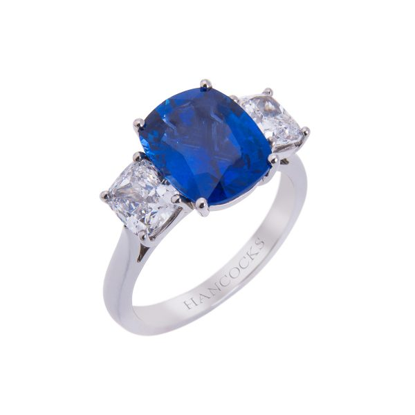 claw set sapphire and diamond ring-in platinum