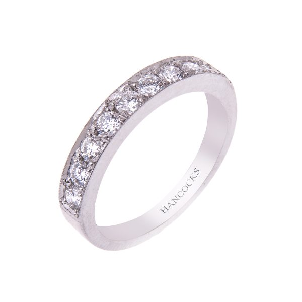 platinum grain set brilliant cut diamond half eternity ring