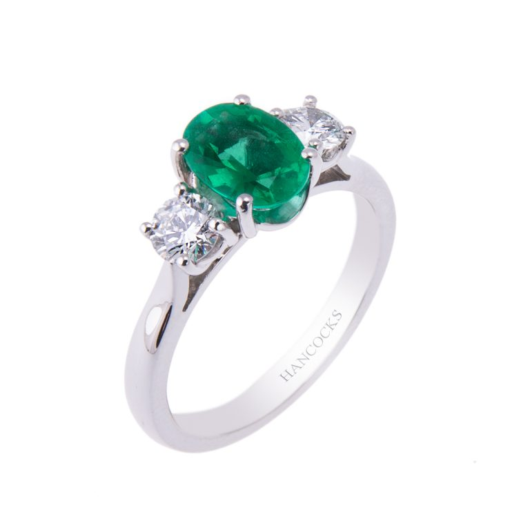 oval-emerald-and-diamond-3-stone-ring