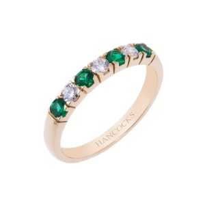 18ct yellow gold claw set emerald and diamond half eternity ring