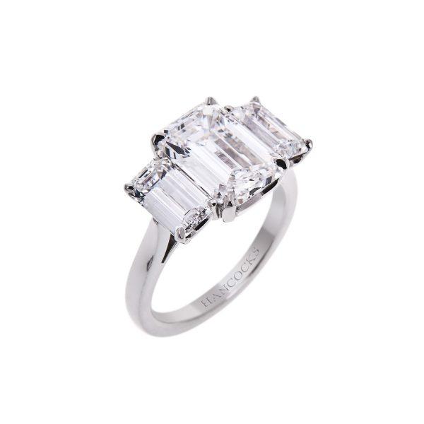 platinum emerald cut diamond trilogy ring