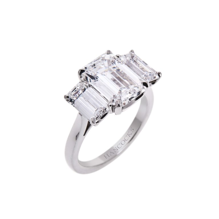 platinum emerald cut diamond trilogy ring