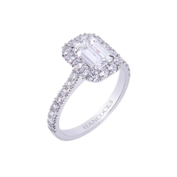 certificated g colour emerald cut diamond ring with halo setting