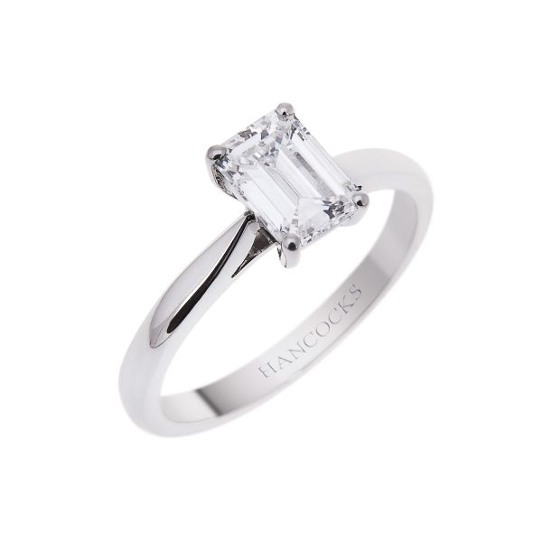 emerald cut diamond solitaire ring mounted in a platinum claw setting