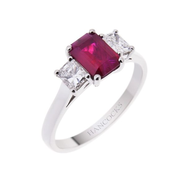 platinum emerald cut ruby and diamond 3-stone ring