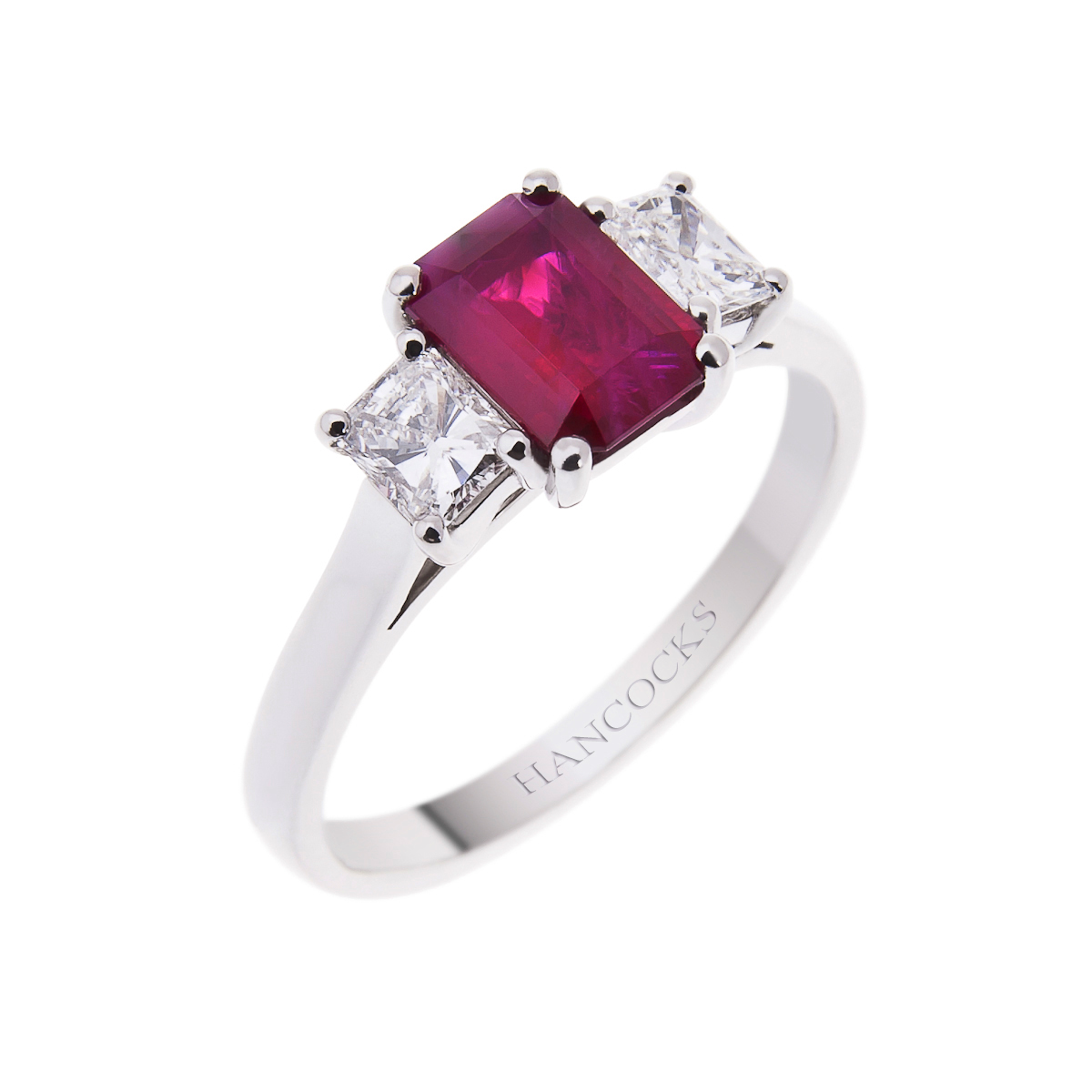 platinum emerald cut ruby and diamond 3-stone ring