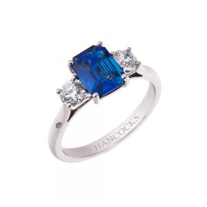 claw set sapphire and diamond 3-stone ring in platinum