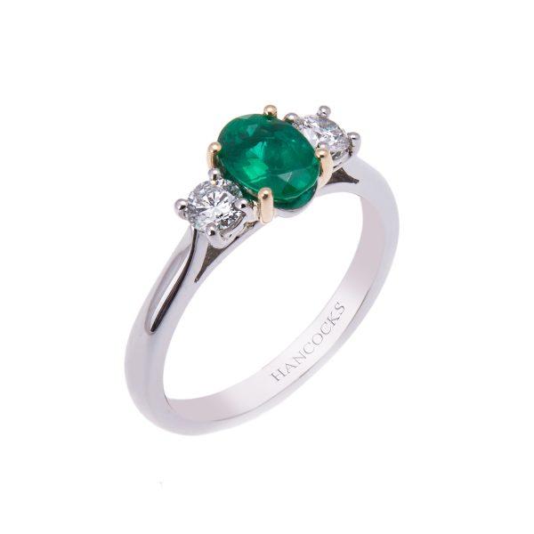 platinum-claw-set-emerald-and-diamond-three-stone-ring