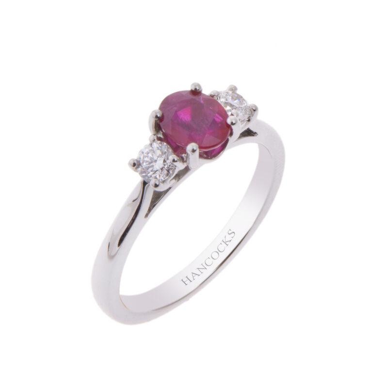 platinum 0.86ct oval ruby and diamond three stone ring
