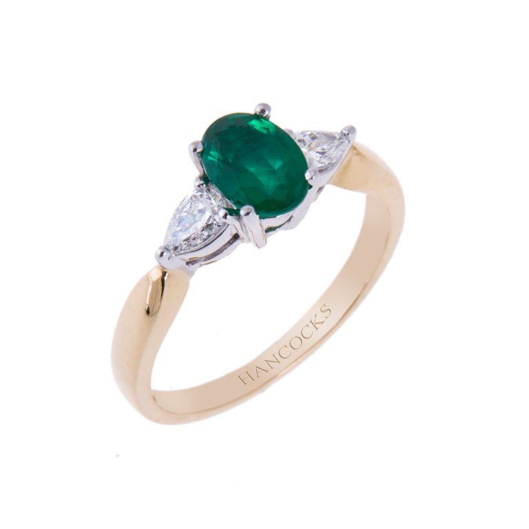 18ct yellow gold emerald and diamond 3-stone ring