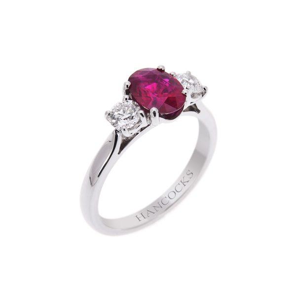 platinum claw set ruby and diamond 3-stone ring