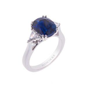 platinum claw set oval sapphire and diamond 3-stone ring