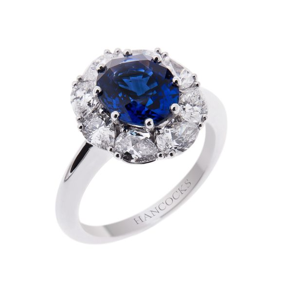 sapphire and diamond claw set cluster ring in platinum