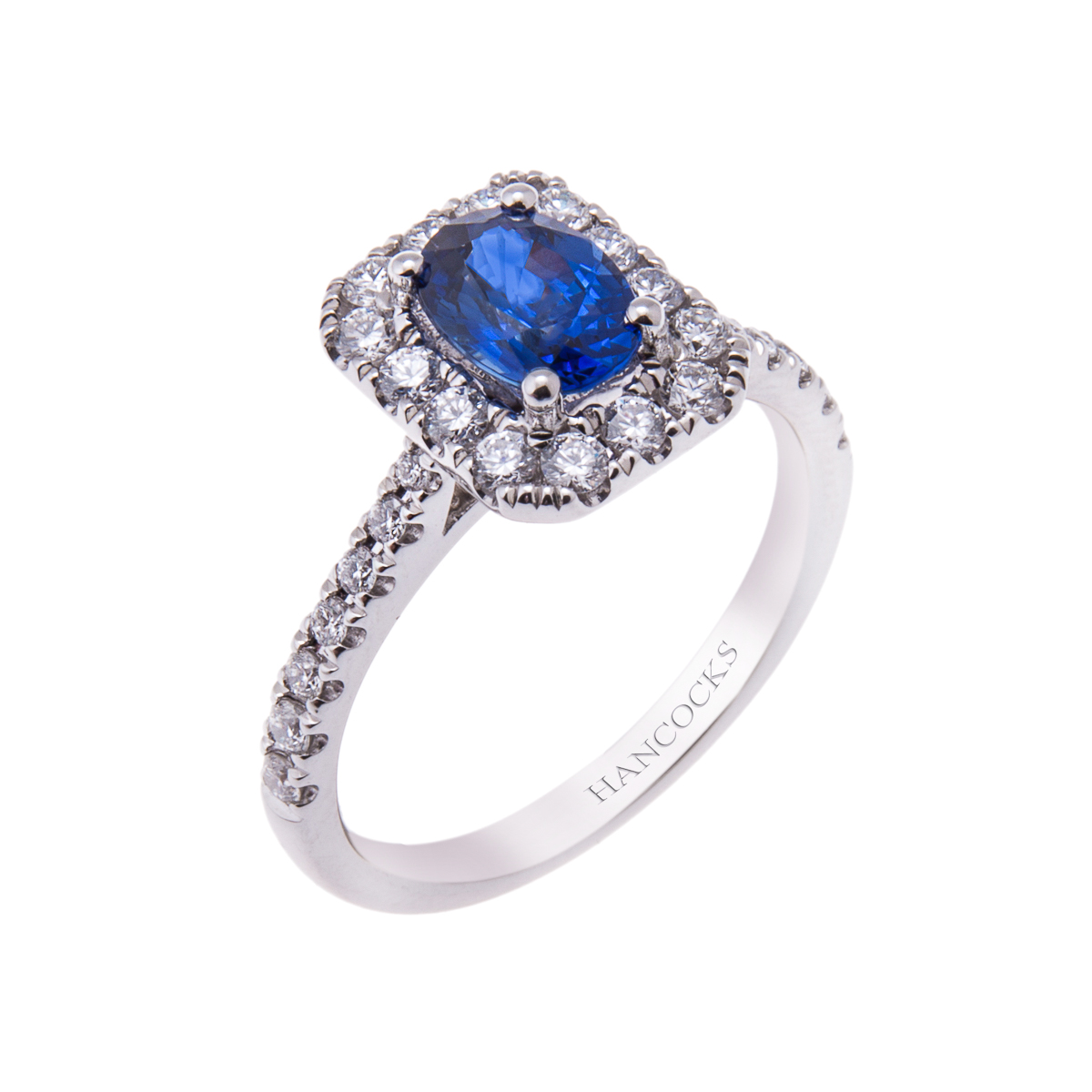 platinum-oval-sapphire-and-diamond-engagement-ring