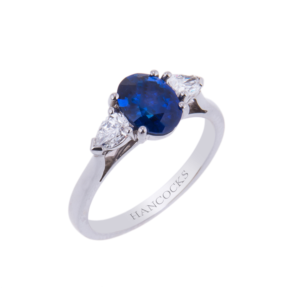 sapphire and diamond 3-stone ring in a platinum claw setting