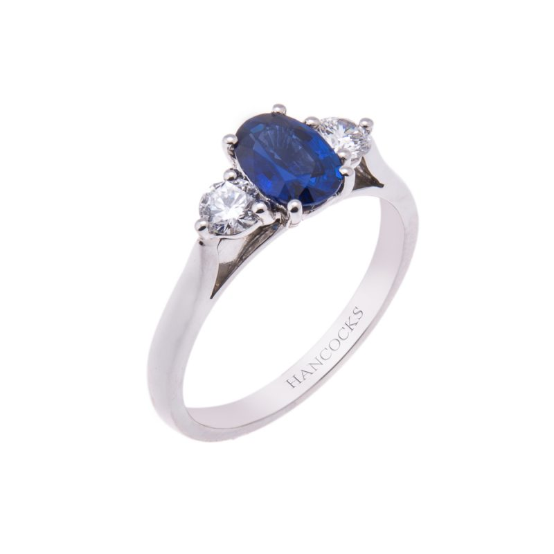 platinum-oval-sapphire-and-diamond-trilogy-ring