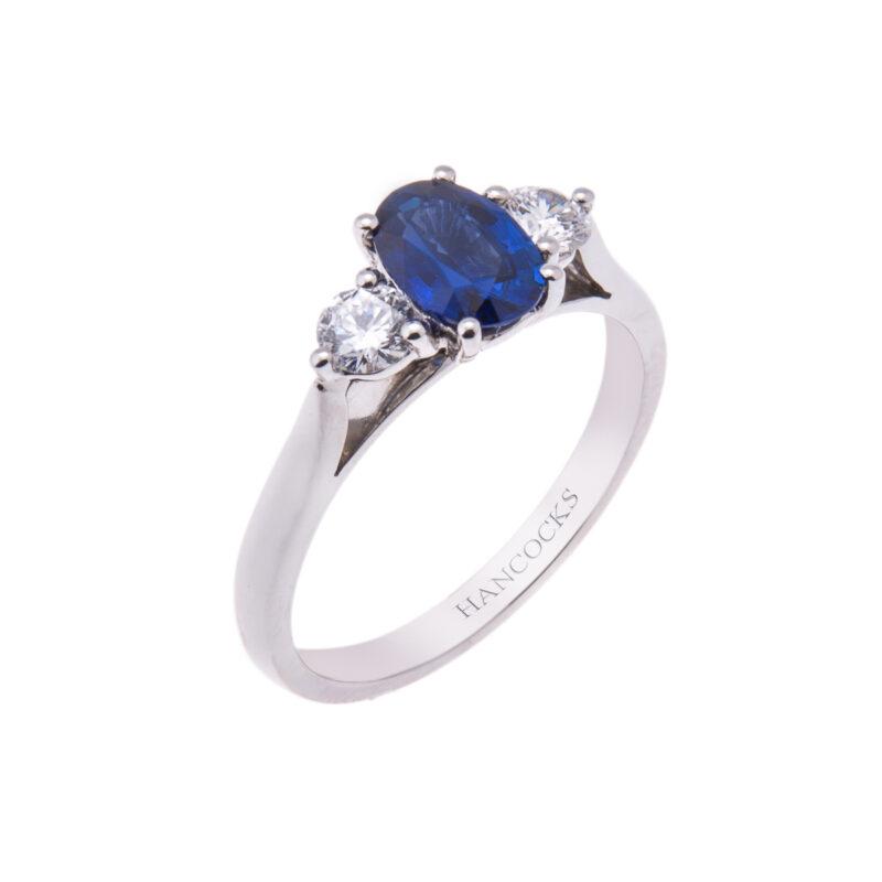 platinum-oval-sapphire-and-diamond-trilogy-ring